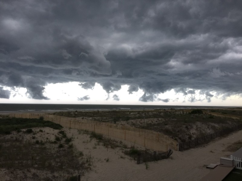 An image of storm clouds over a beach.