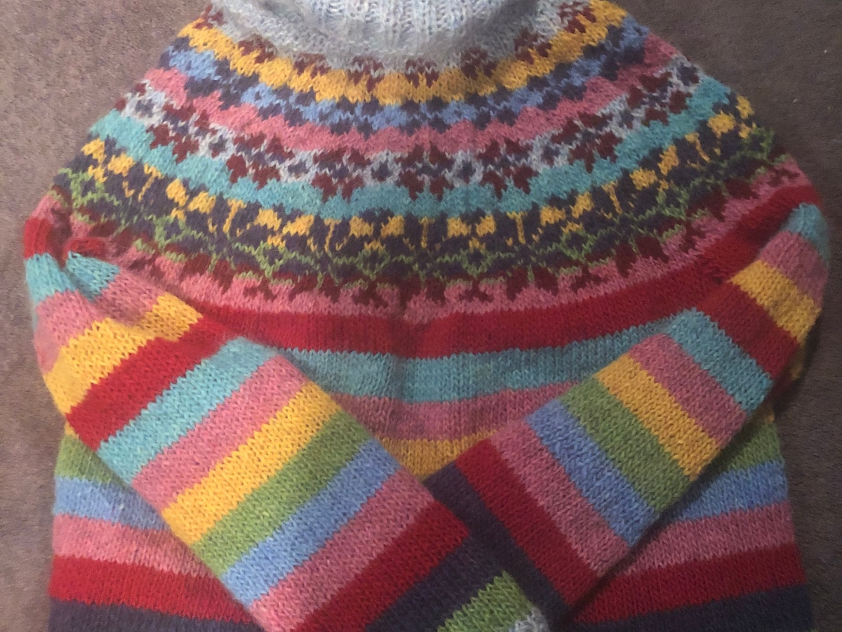 A picture of a colorful handwoven sweater.